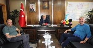 Saral ve Özbek'ten Başkan Pekmezci'ye...